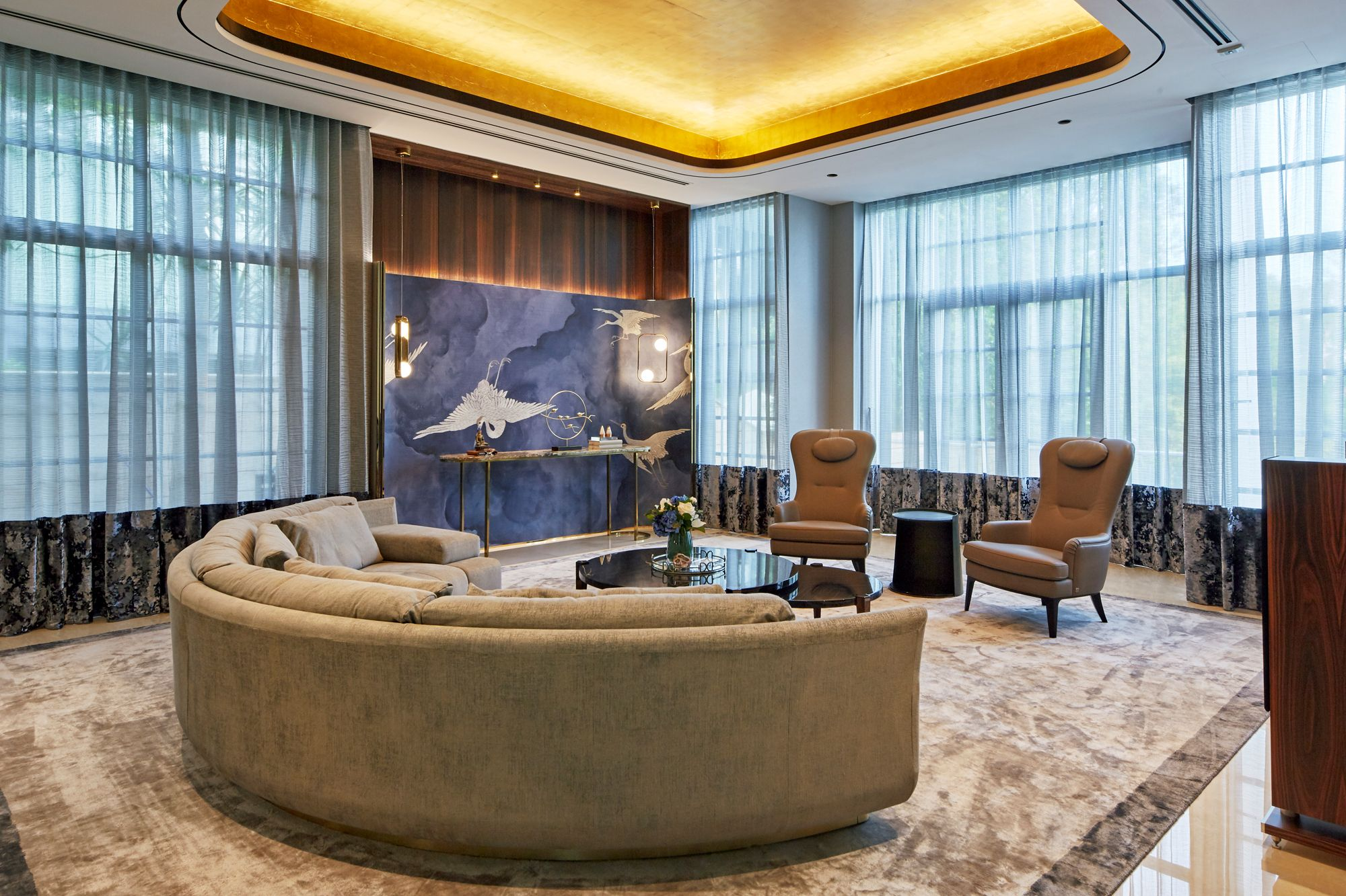 The formal living room, one of KGID's favourite spaces, features a blue Philip Jeffries crane wall covering that adds a pop of colour