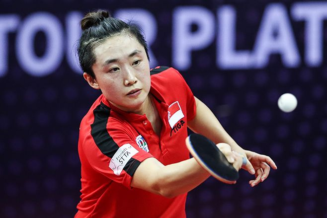 Feng Tianwei of Singapore in action at the women's singles Round of 16 compete with Sato Hitomi of Japan. (Photo: Getty Images)