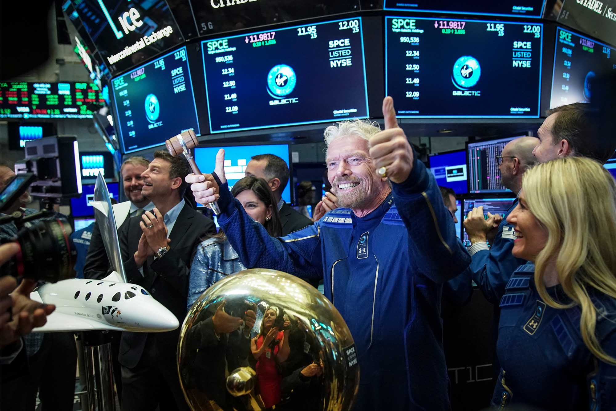 Sir Richard Branson, Founder of Virgin Galactic, gives the thumbs up after ringing a ceremonial bell on the floor of the New York Stock Exchange. (Photo: Getty Images)