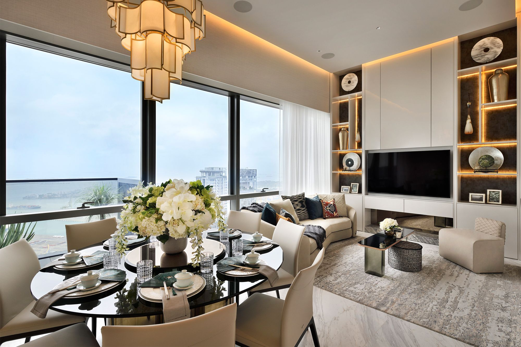 An elegant apartment accentuated by layers of off-white furnishings and styling elements