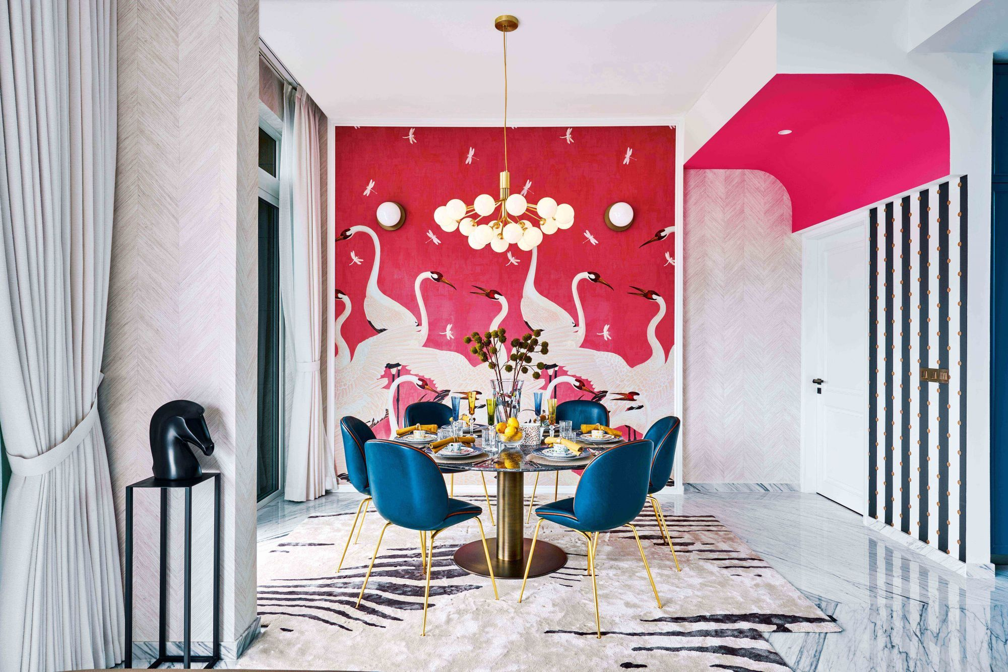 Home Tour: A Pink Gucci Wallpaper Is The Focal Point Of This Travel-Themed Apartment