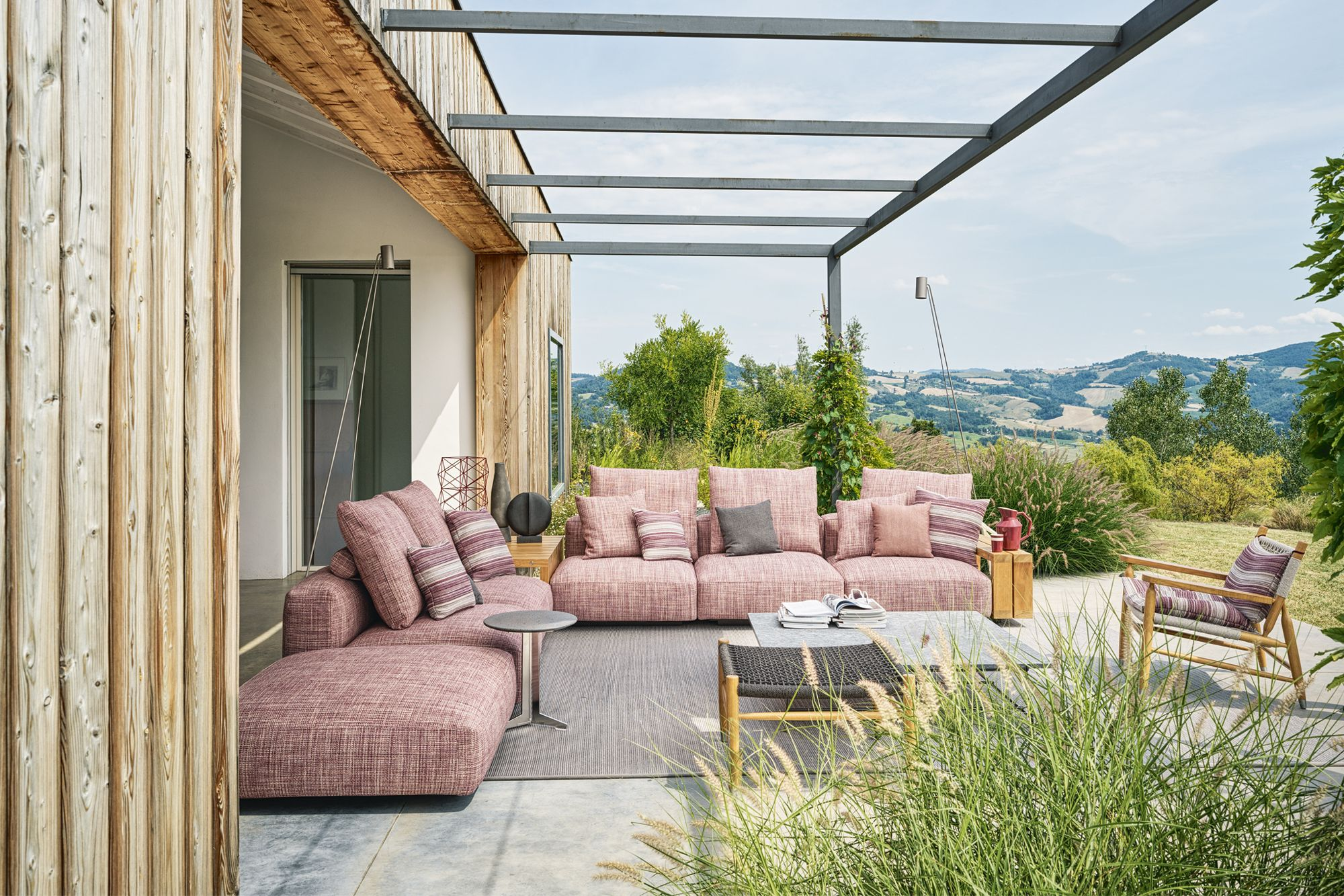 The Flexform Tessa armchair on the terrace is Donini's favourite reading spot
