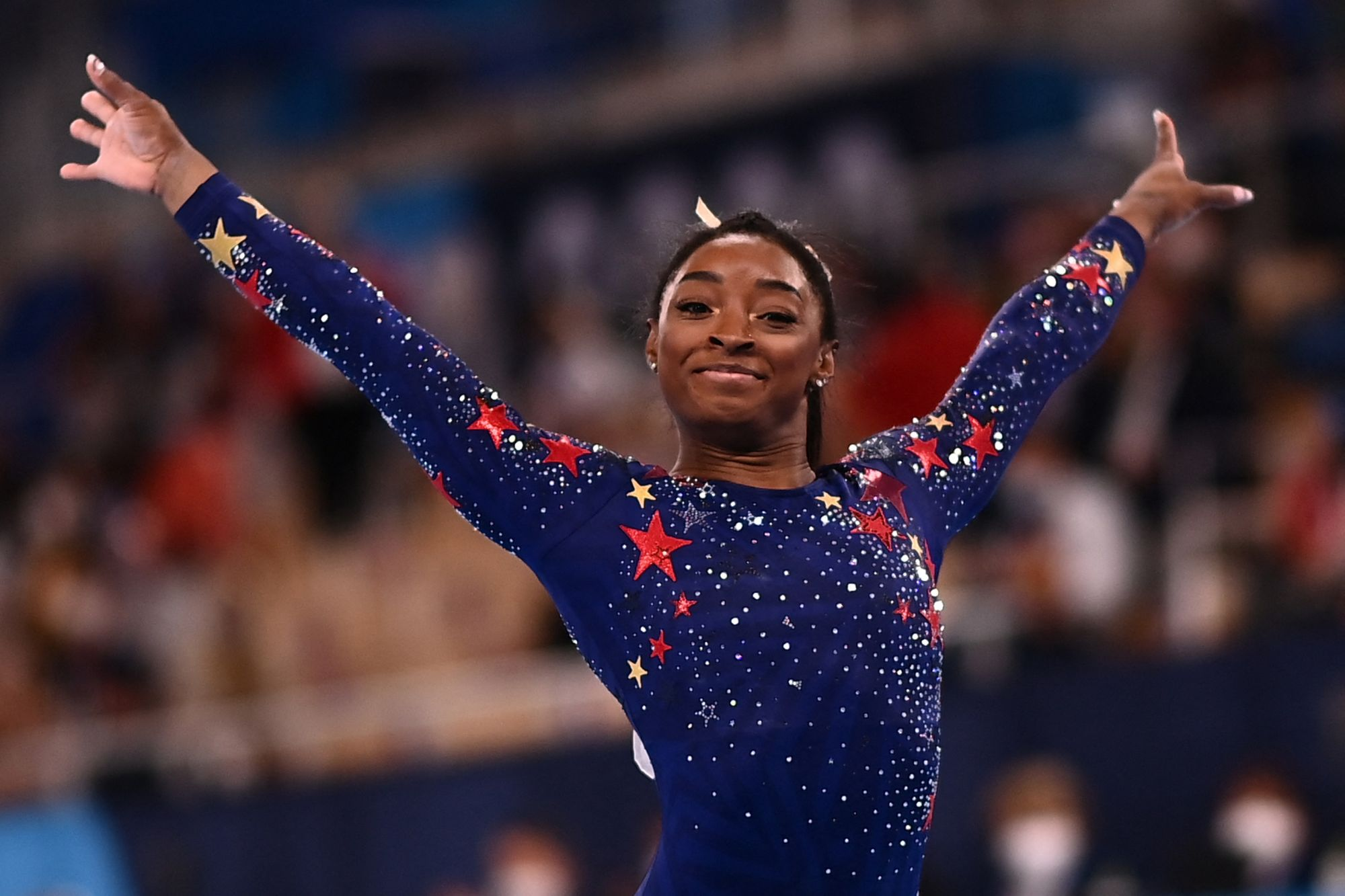 (FILES) In this file photo taken on July 25, 2021 US's Simone Biles reacts after competing in the artistic gymnastics balance beam event of the women's qualification during the Tokyo 2020 Olympic Games at the Ariake Gymnastics Centre in Tokyo. - Simone Biles withdrew from Olympics all-around gymnastics on July 28, 2021. (Photo by Loic VENANCE / AFP)