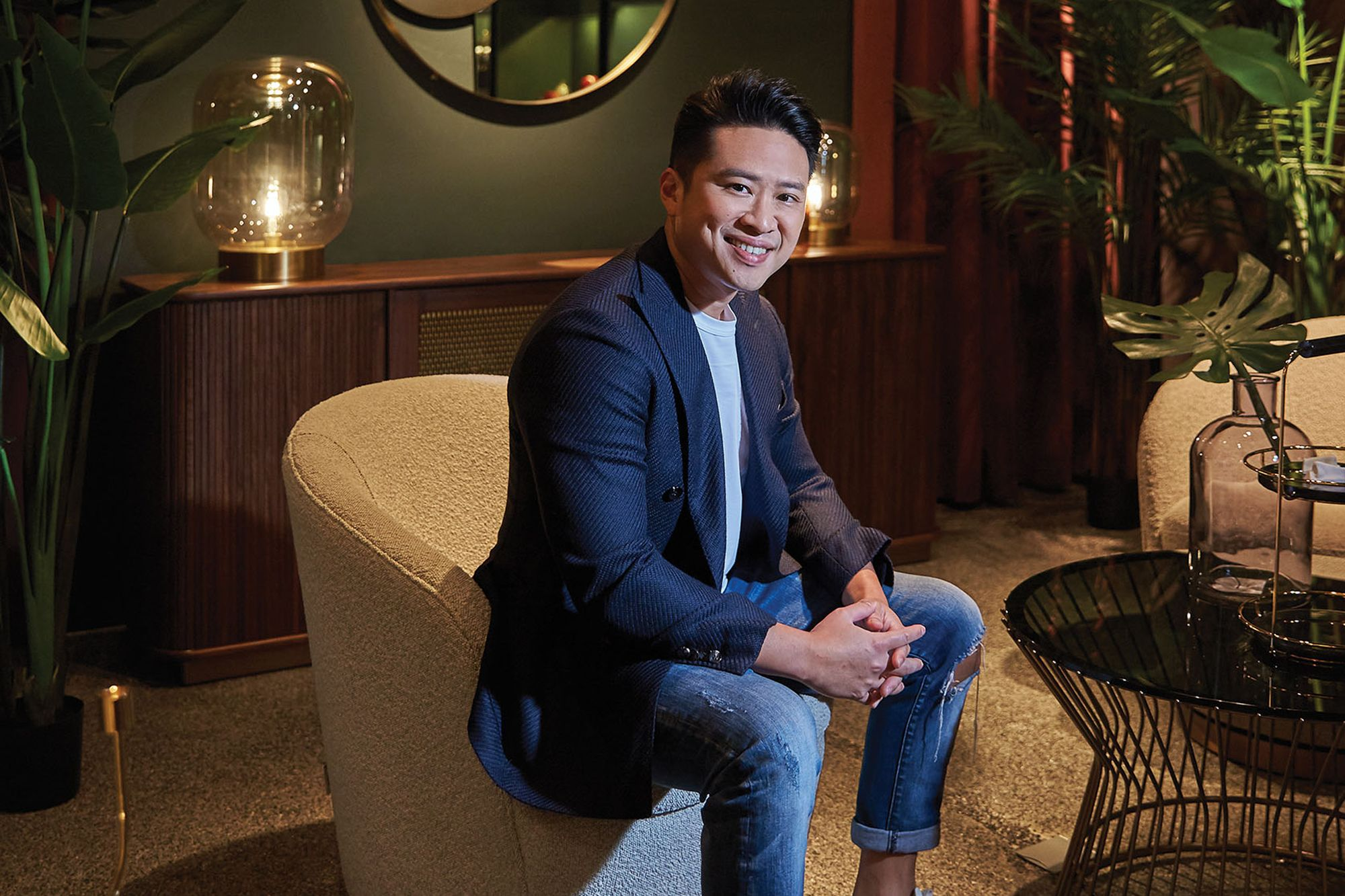 Commune chief design officer Julian Koh sits at the Alt.o section of the brand's Millenia Walk showroom