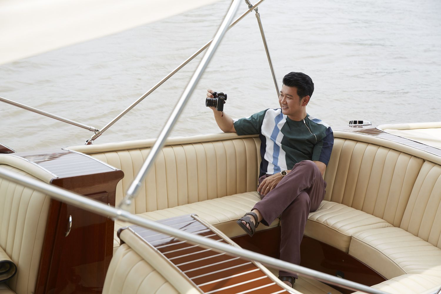 A keen photographer, Sornsak, in a casual ensemble by Hermès, takes pictures with his favourite Leica camera