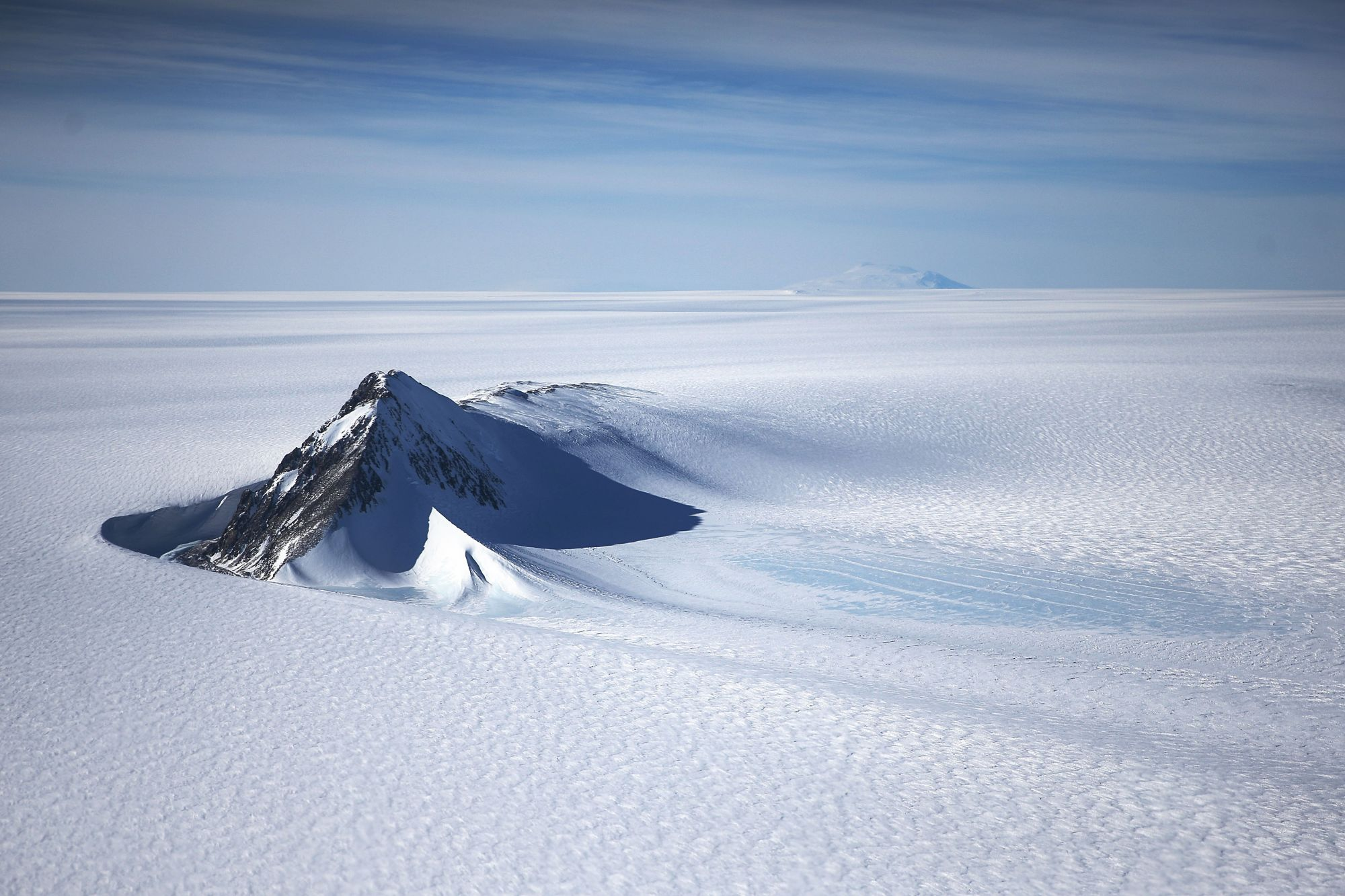 ANTARCTICA - OCTOBER 28:  A section of the West Antarctic Ice Sheet with mountains is viewed from a window of a NASA Operation IceBridge airplane on October 28, 2016 in-flight over Antarctica. NASA's Operation IceBridge has been studying how polar ice has evolved over the past eight years and is currently flying a set of 12-hour research flights over West Antarctica at the start of the melt season. Researchers have used the IceBridge data to observe that the West Antarctic Ice Sheet may be in a state of irr