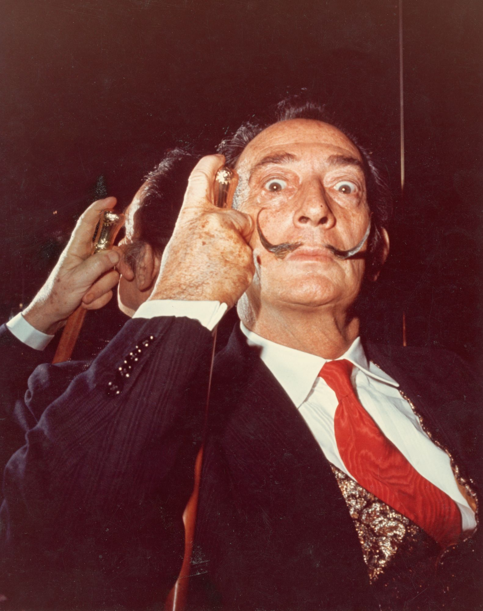 Portrait of Spanish artist Salvador Dali (1904 - 1989) with his cane, 1960s. (Photo by Hulton Archive/Getty Images)