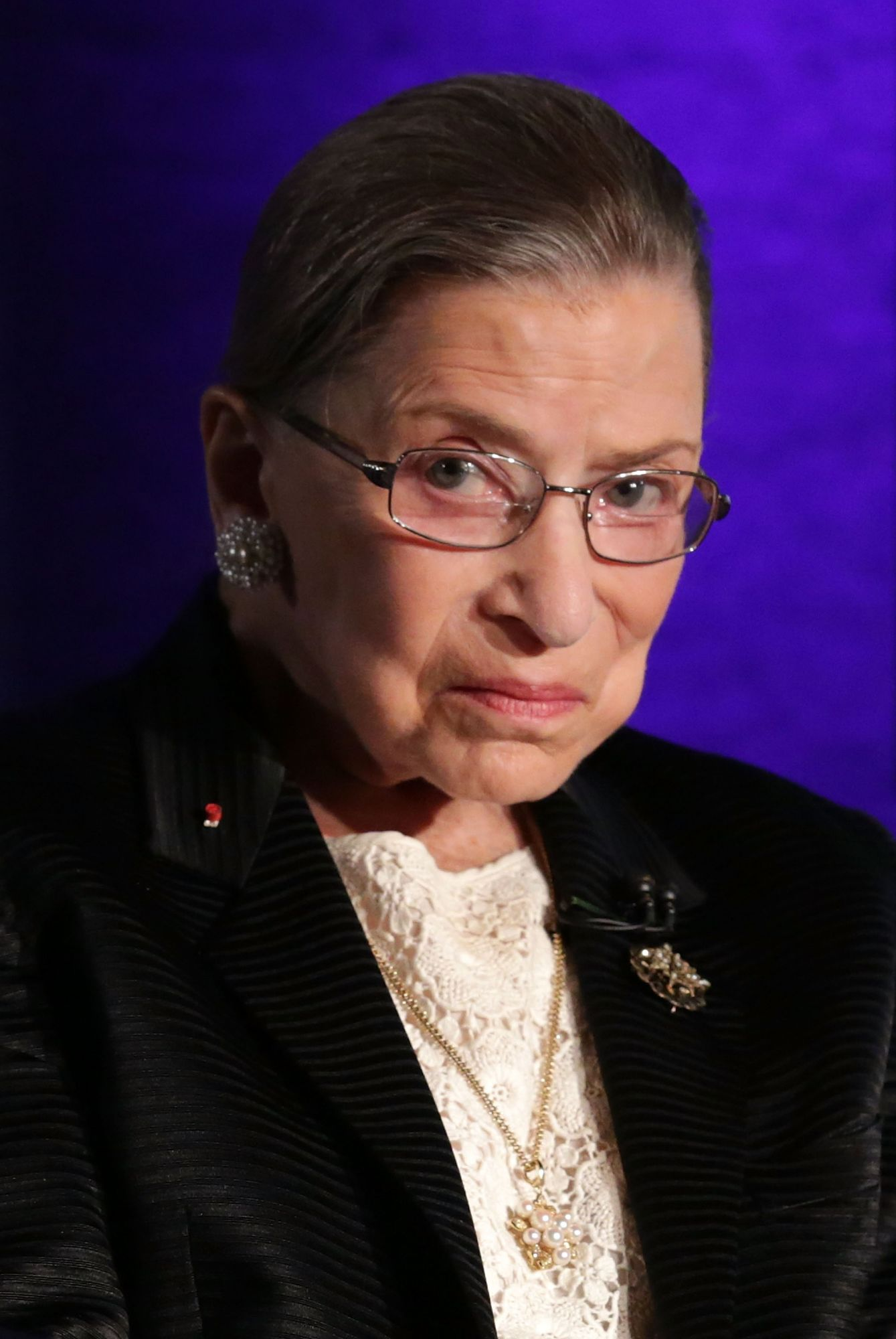 """WASHINGTON, DC - APRIL 17:  Supreme Court Justice Ruth Bader Ginsburg waits for the beginning of the taping of """"The Kalb Report"""" April 17, 2014 at the National Press Club in Washington, DC. The Kalb Report is a discussion of media ethics and responsibility at the National Press Club held each month. (Photo by Alex Wong/Getty Images)"""