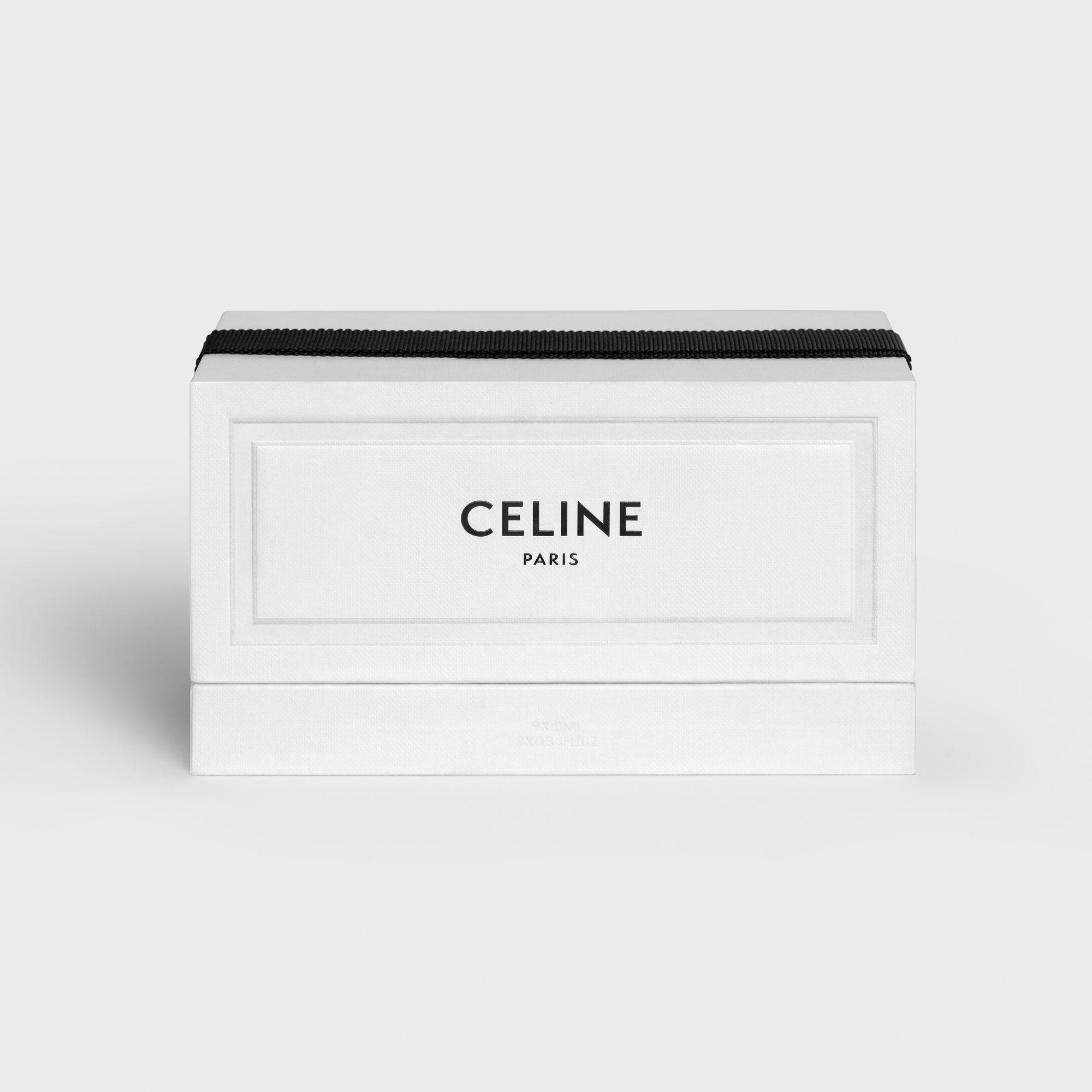 迷你香水禮盒飾以壓紋絨面紙,純白禮盒綁上黑色羅緞蝴蝶結