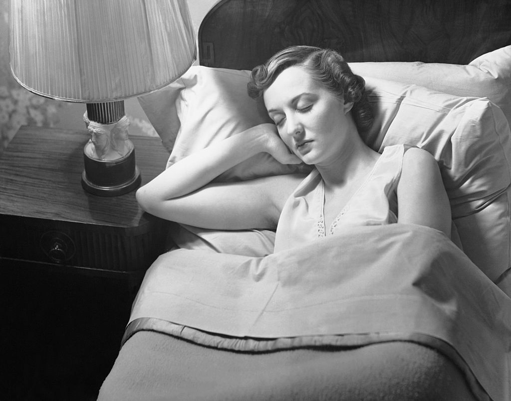 UNITED STATES - CIRCA 1950s:  Woman sleeping in bed.  (Photo by George Marks/Retrofile/Getty Images)
