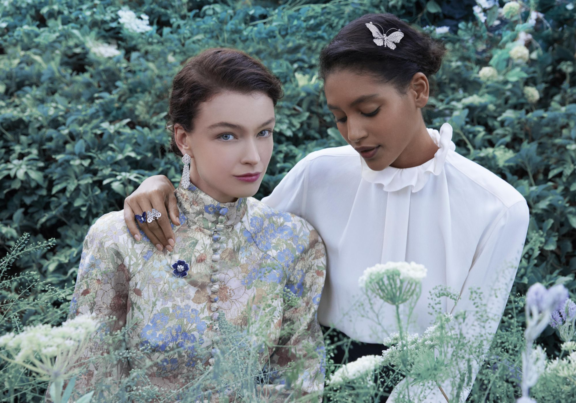Photo by Erik Madigan Heck - Spring shooting 2021À Cheval earrings with detachable pendants, platinum, white gold, diamondsPetit Gloxinia clip, platinum, rose gold, white gold, Traditional Mystery Set sapphires, diamondsFlying Butterfly Between the Finger Ring, white gold, rose gold, buff-topped Traditional Mystery Set sapphires, diamondsBelle-dame butterfly clip, white gold, diamonds