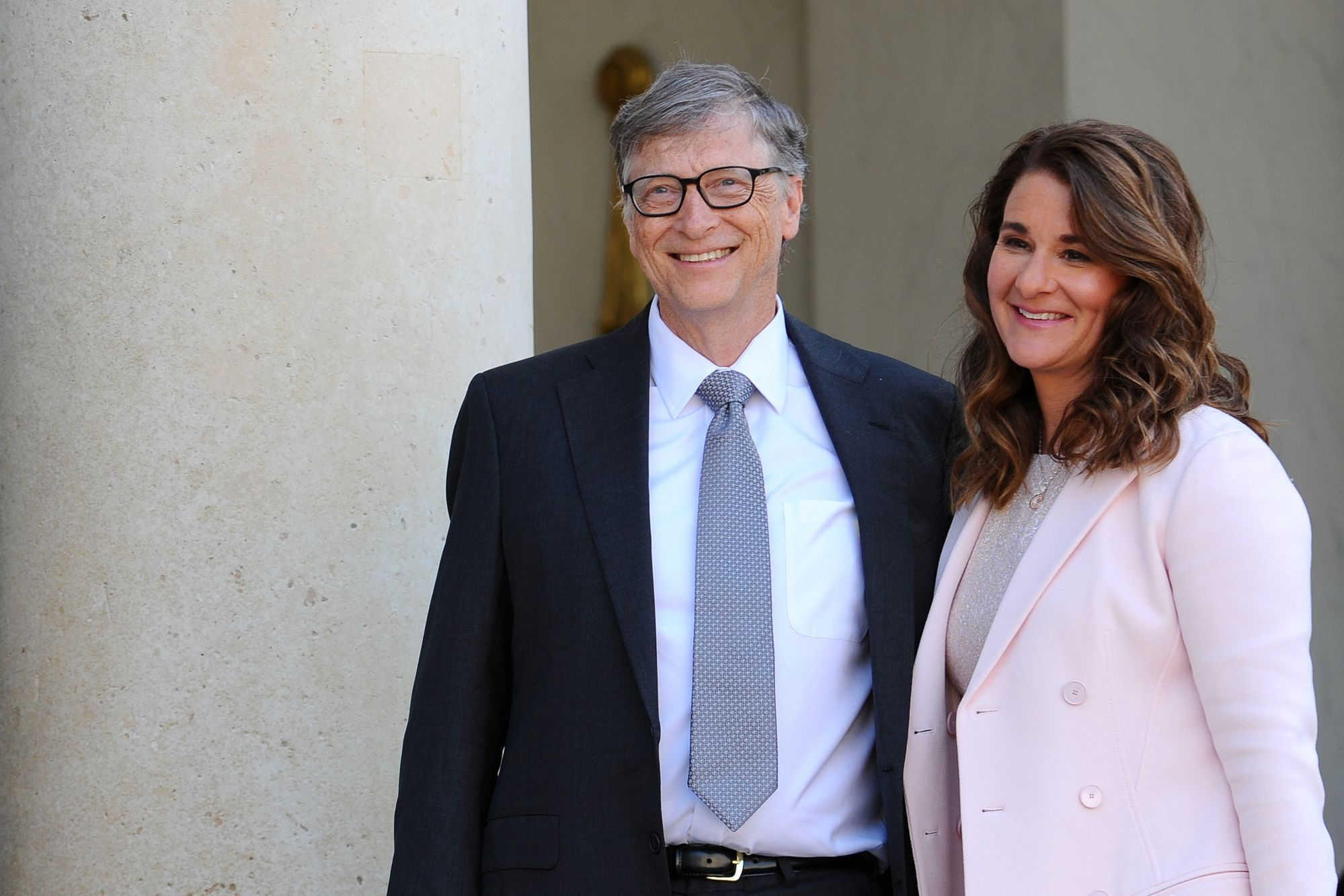 PARIS, FRANCE - APRIL 21: Bill and Melinda Gates pose in front of the Elysee Palace before receiving the award of Commander of the Legion of Honor by French President Francois Hollande on April 21, 2017 in Paris, France. French President Franois Hollande awarded the Honorary Commander of the Legion of Honor to Bill and Melinda Gates as the highest national award under the partnership between France and the Bill & Melinda Gates Foundation, which have been unavoidable actors for several years Of development