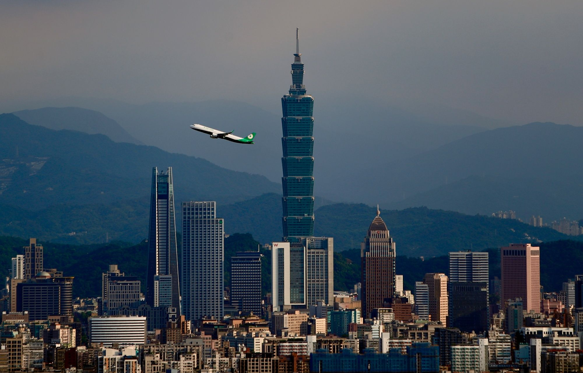 A domestic flight connecting Taipei City to Nangan Township departs from Songshan Airport and passes through in front of the Taipei 101 building, amid the spread of the Covid-19 pandemic, Taipei City, Taiwan, 12 July 2020.Unlike other countries like India and the United Kingdom where full and partial bans upon domestic flights have been in place , respectively since the pandemic started to spread, airlines for domestic travellers in Taiwan have not been affected as no suspension was stepped up by the govern