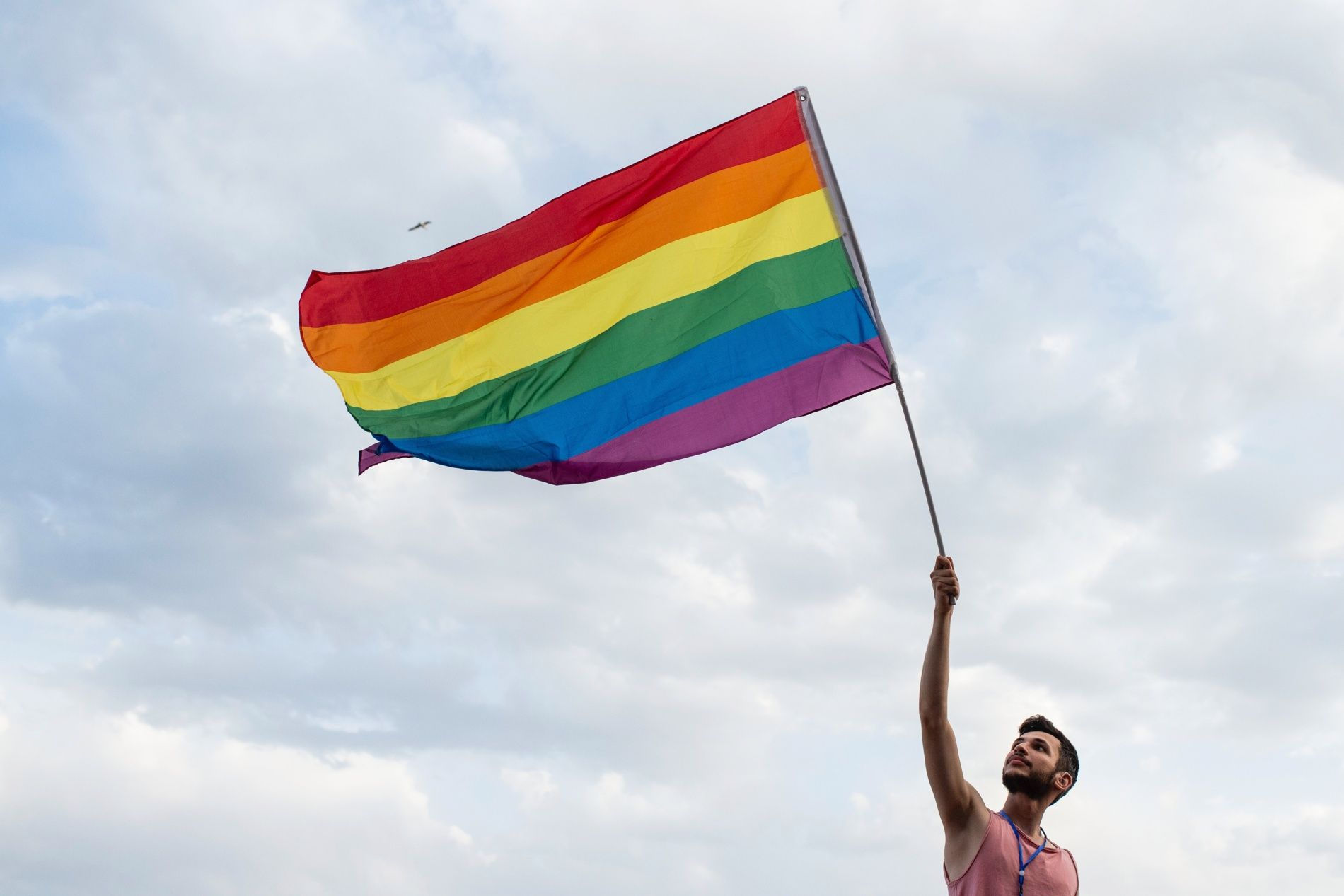 NAPLES, ITALY - JUNE 22: An activist of the LGBT movement with a flag during the 12th Mediterranean Pride of Naples on June 22, 2019 in Naples, Italy. The Mediterranean Pride of Naples is one of the many events of Pride Month scheduled in Italy and around the world, inspired by the Stonewall riots of 1969, when protests and clashes between police and homosexual groups took place in New York, symbolically the moment of birth of the modern gay liberation movement throughout the world. (Photo by Ivan Romano/Ge