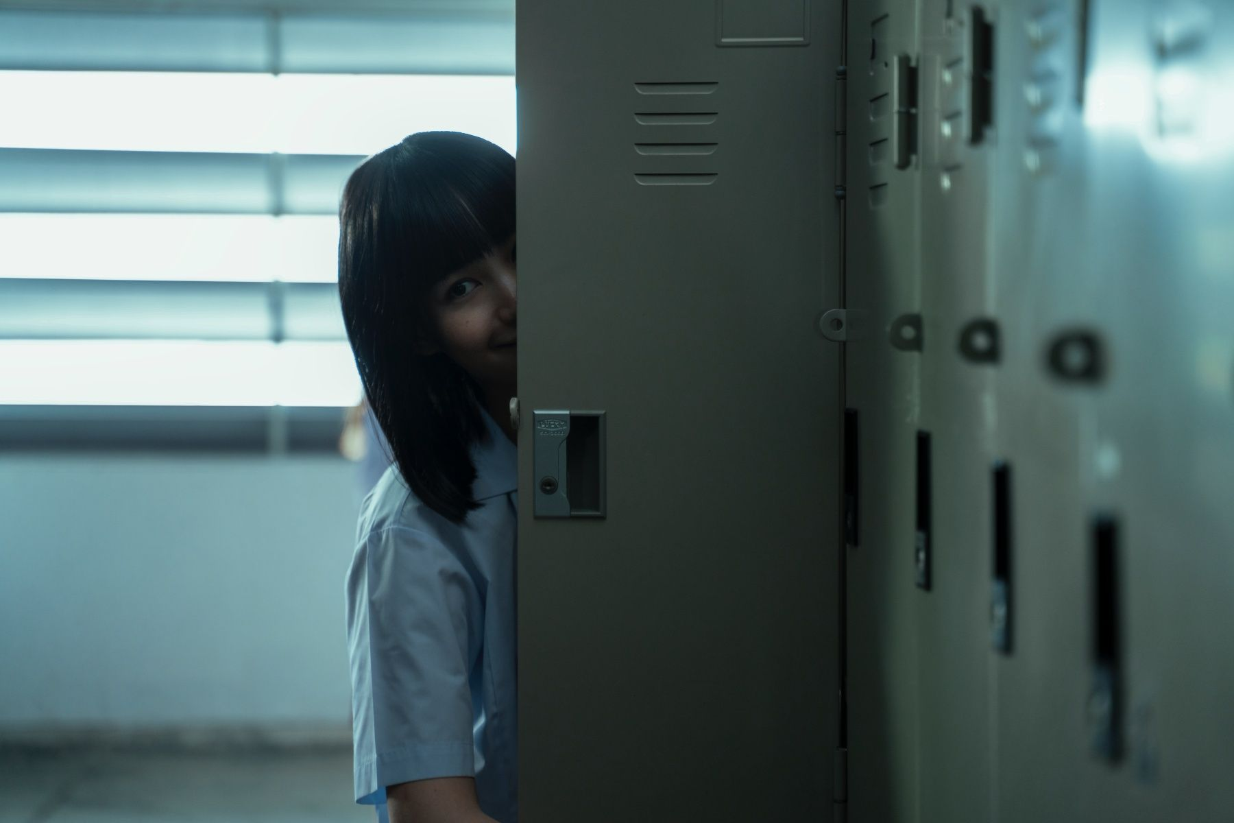 GIRL FROM NOWHERE (L to R) KITTY CHICHA AMATAYAKUL as NANNO in episode 204 of GIRL FROM NOWHERE Cr. YUPANAKORN BOONPREM/NETFLIX © 2021