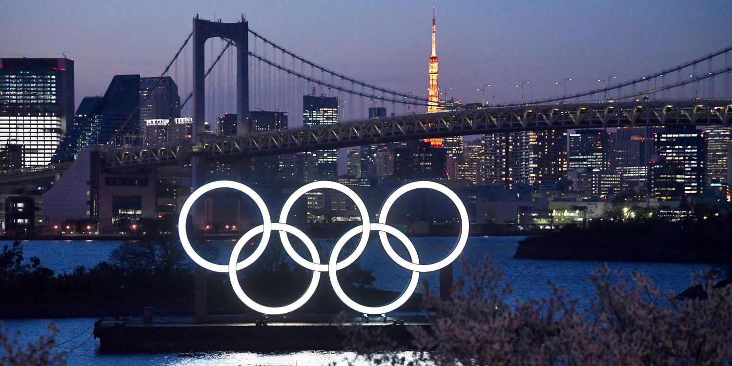 TOKYO, JAPAN - MARCH 25: A boat sails past the Tokyo 2020 Olympic Rings on March 25, 2020 in Tokyo, Japan. Following yesterday's announcement that the Tokyo 2020 Olympics will be postponed to 2021 because of the ongoing Covid-19 coronavirus pandemic, IOC officials have said they hope to confirm a new Olympics date 'as soon as possible'. (Photo by Carl Court/Getty Images)