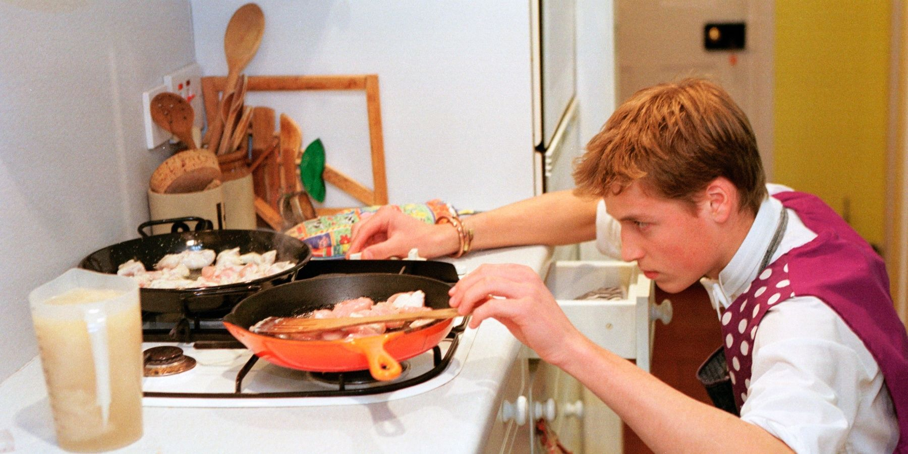 WINDSOR, UNITED KINGDOM - JUNE 17:  Prince William Cooking Chicken Paella During His Boarding School Days At Eton College  (Photo by Tim Graham Picture Library/Getty Images)