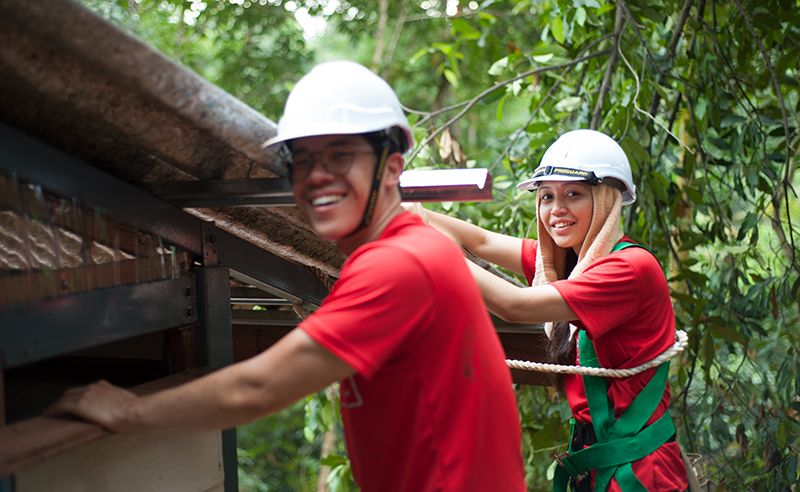 Bryan Lim and Jeanette Simbat working on the roof.