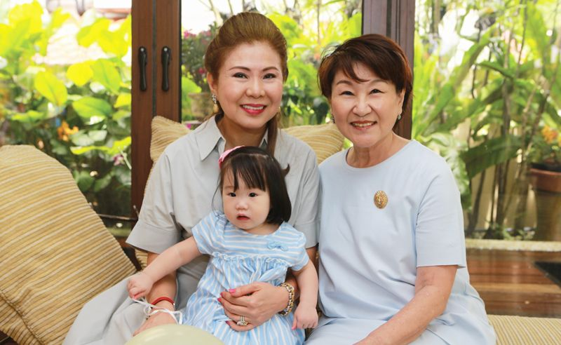 Tan Rue Mae with her grandmothers Puan Sri Wendy Lim and Connie Tan