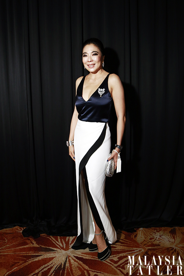 Lim Wei-Ling in Galvan dress, Chanel necklace and Piaget clutch