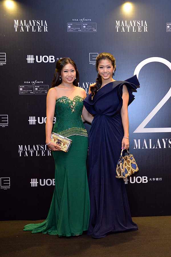 Lim May Shen in Innai Red and Lim May Jian in Chai Gold Label