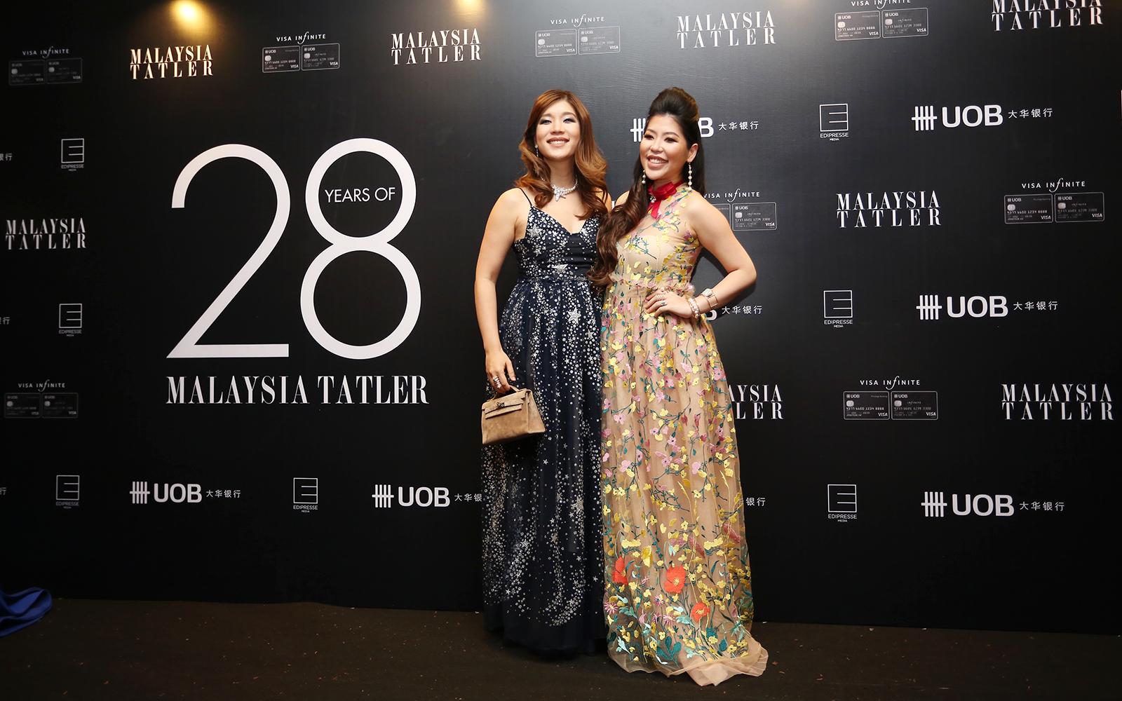 Shen-Tel Lee and Elizabeth Lee-Yong in Jonathan Liang and Bowerhaus accessories