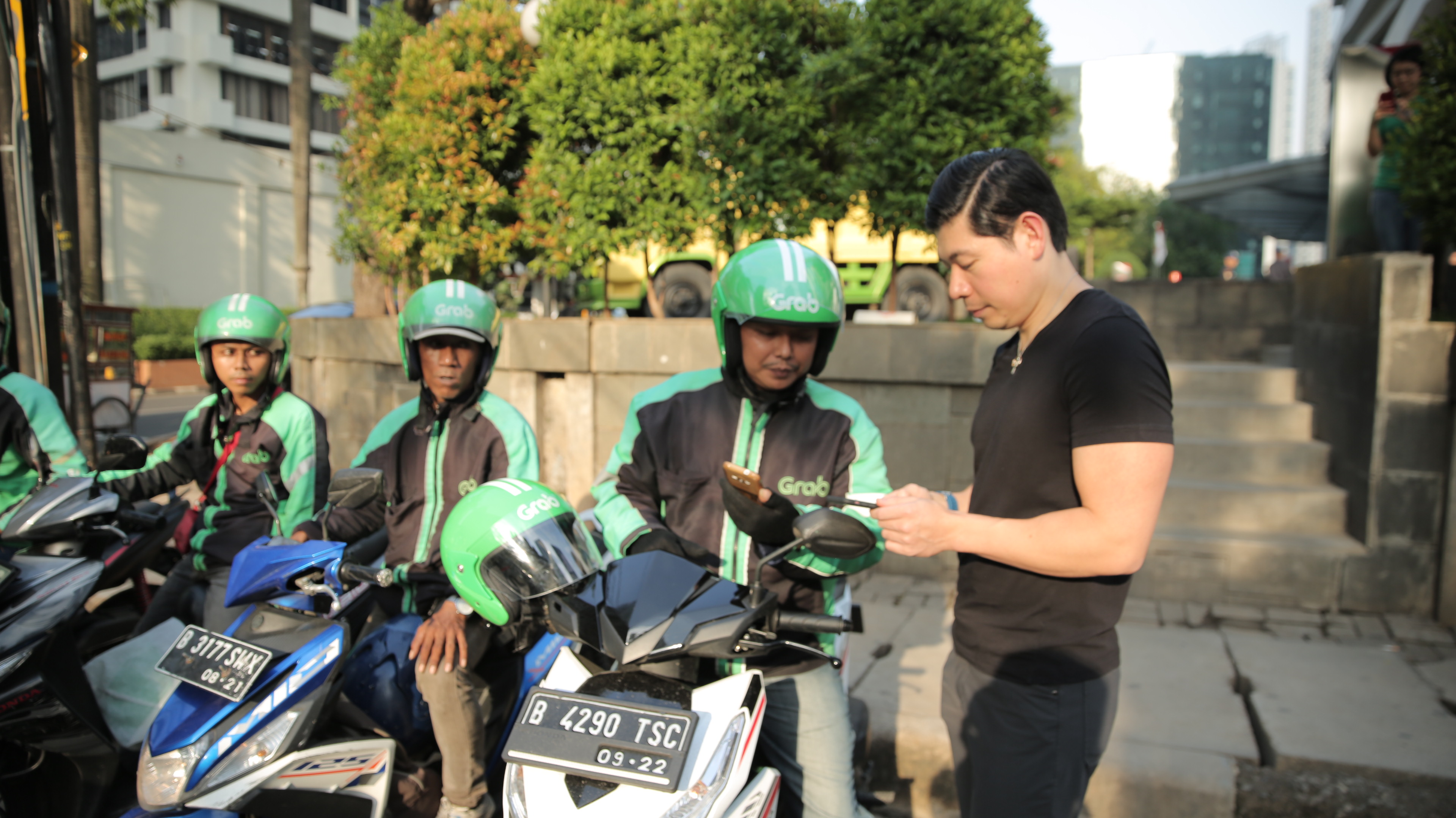 Anthony Tan talking to Grab Bikers in Indonesia | Malaysia Tatler