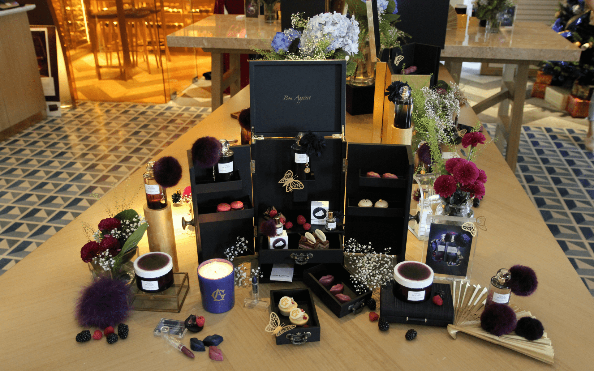Annick Goutal fragrances daintily laid out as tabletop deco