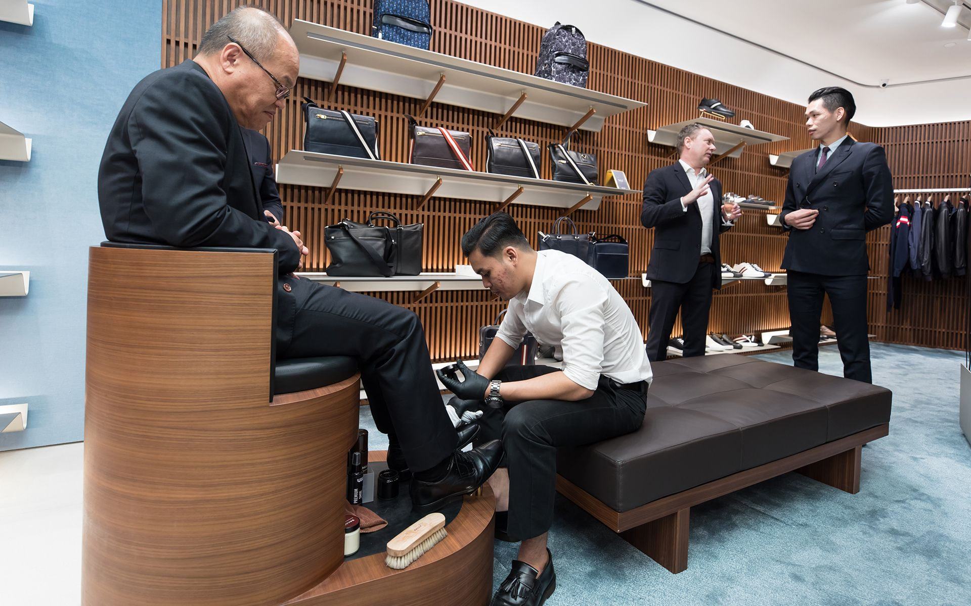 Guests enjoying the personalised service in Bally's contemporary new store design