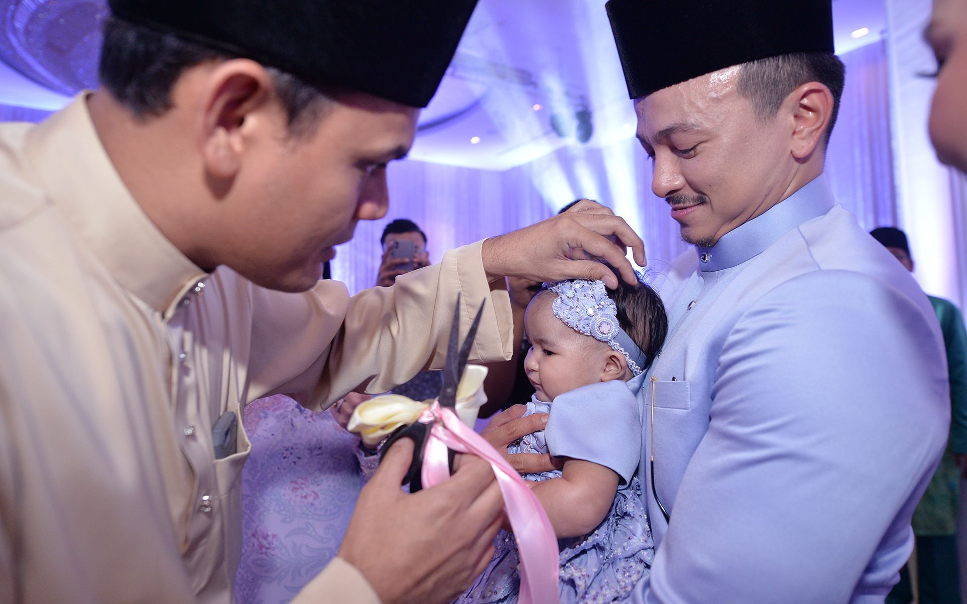 Godfather Yusry Abdul Halim snipping Jeanelle's hair