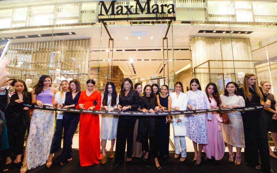 All the ladies dressed in Max Mara line up for the ribbon cutting ceremony