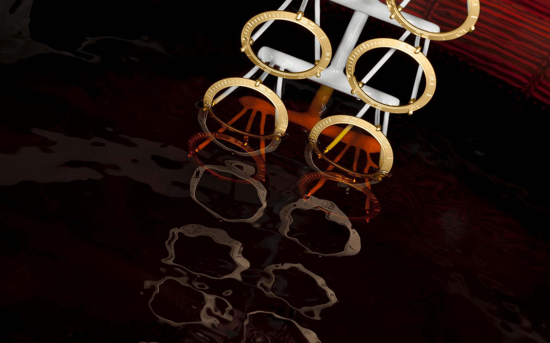 Ceramic rings dipped in gold bath (Photo: Omega)