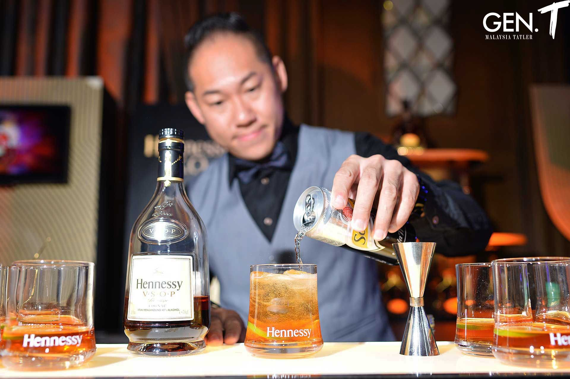 Henry Tan mixing up Hennessy cocktails for the night