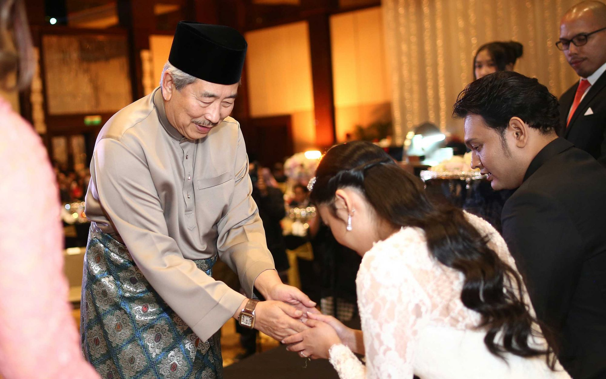 Tengku Ahmad Shah Alhaj giving the bride his blessings