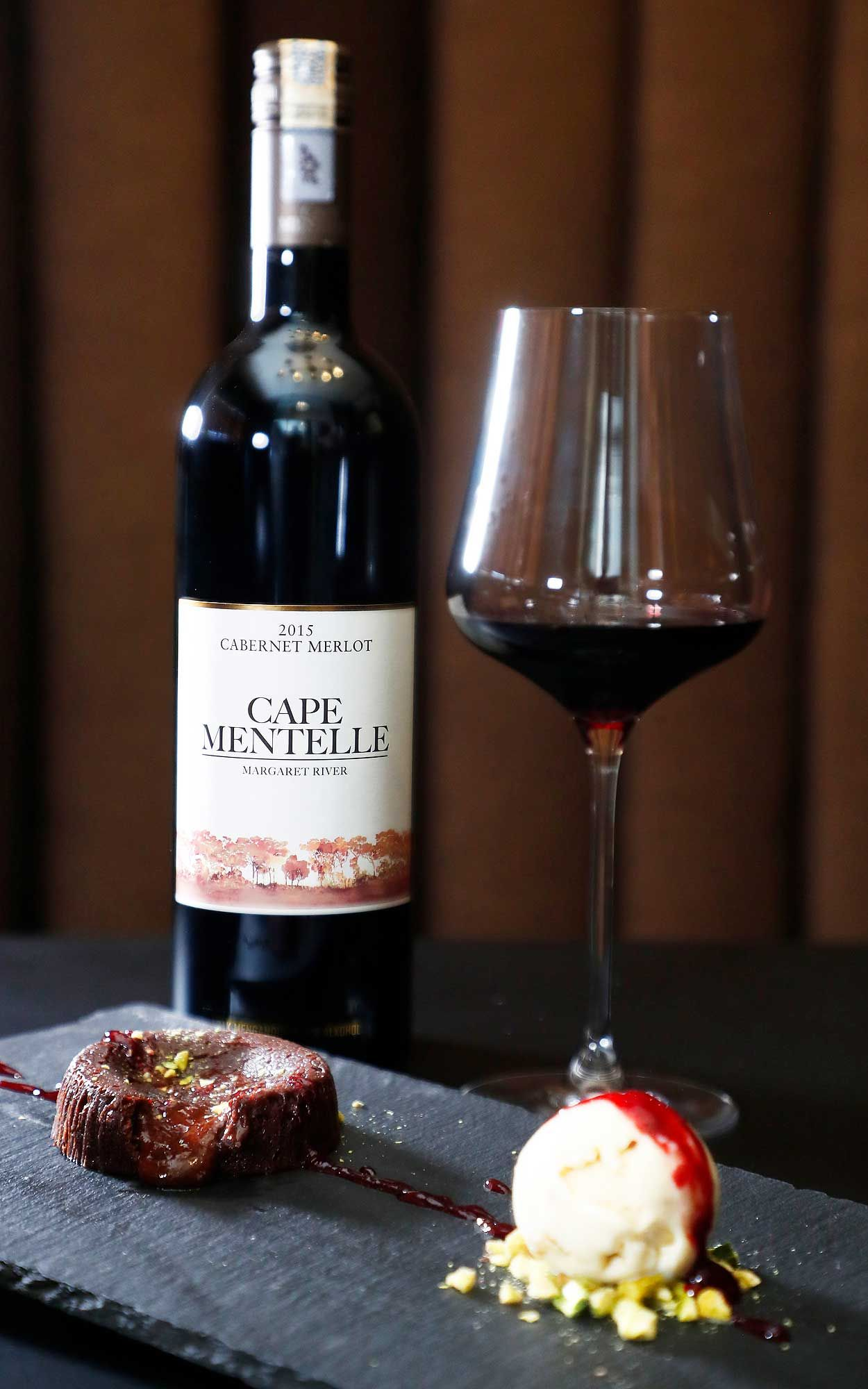 The Cape Mentelle cabernet Merlot 2015 paired with chocolate lava cake, raspberry coulis, pistachio, and rum & raisin ice cream. Photo: Credit Bonnie Yap