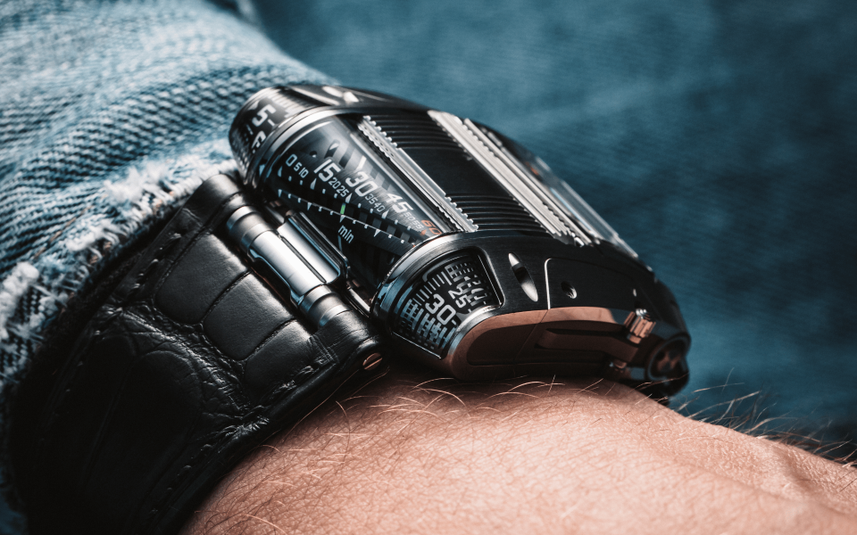 UC-111C has a linear time display with cylindrical minute track and jumping hour (Photo: Urwerk)