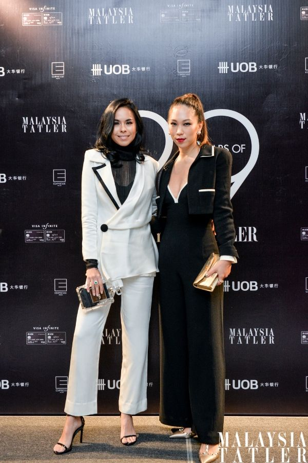 Kim Raymond in Afiq M and Diane Chia in vintage Chanel