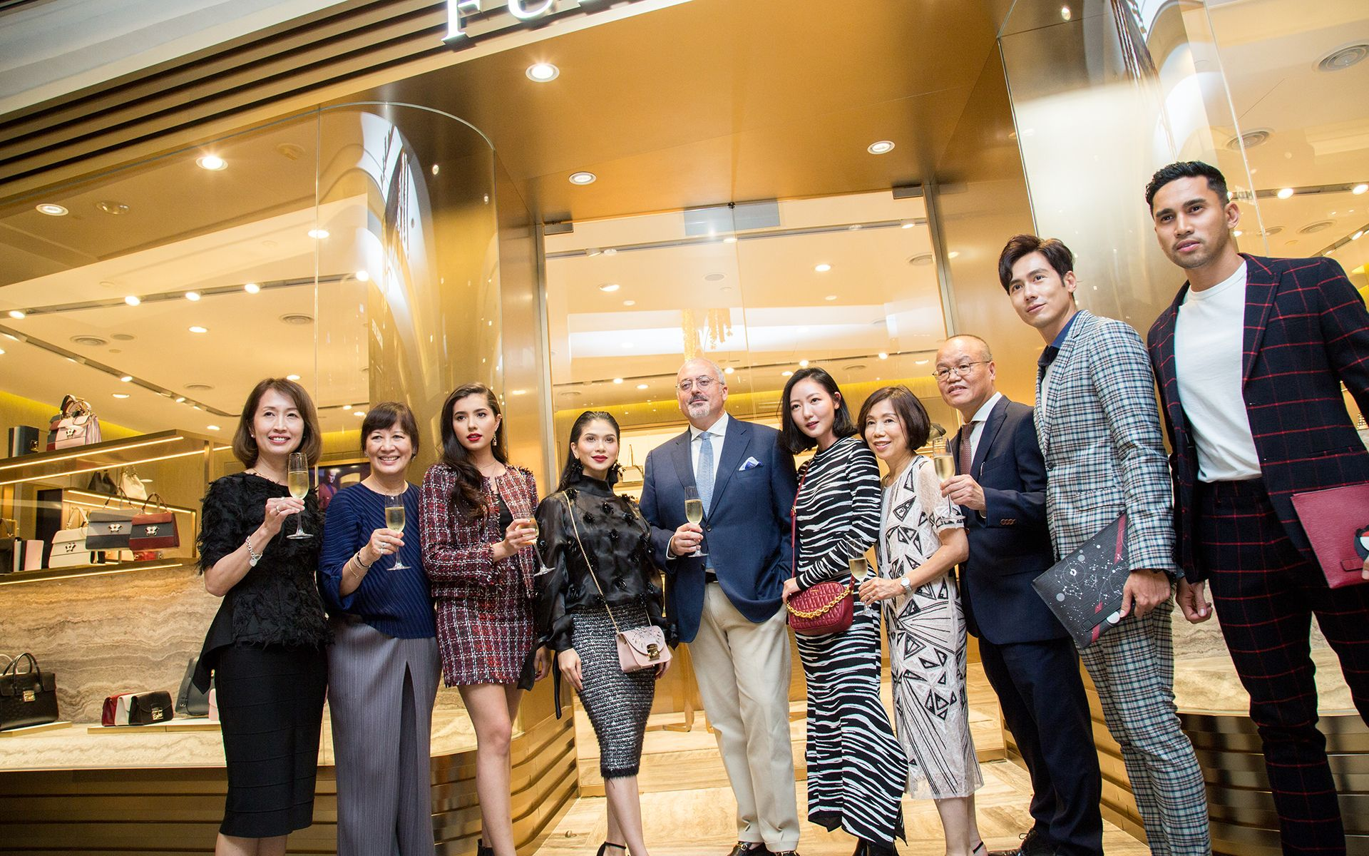 Furla CEO of Asia Pacific Alessandro Bartoli (centre) officiates the store opening with celebrity guests