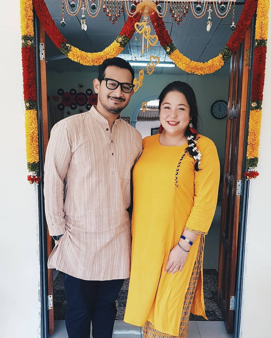 Cheery Ili Sulaiman dons a canary yellow outfit, primed to kick off the bright occasion with her beau. Photo: Courtesy of @ilisulaiman / Instagram