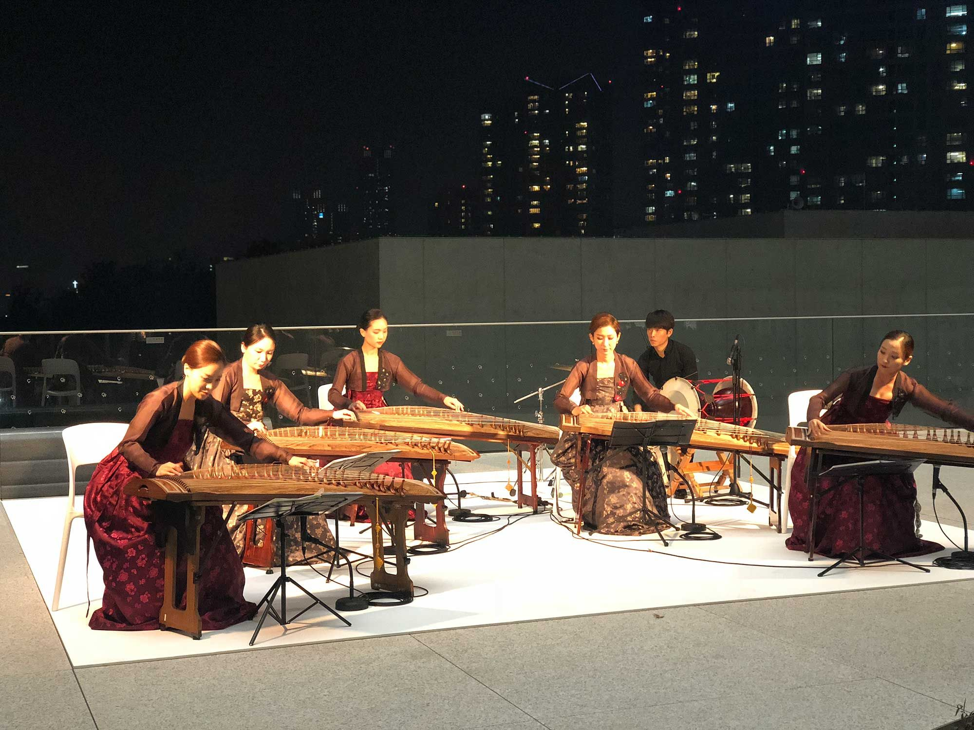 Musicians playing the Gayageum, a traditional Korean string instrument. Photo: Courtesy of Sulwhasoo.