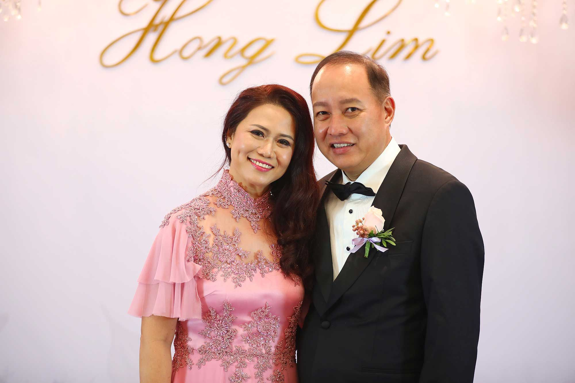 Parents of the groom, Remie Yap and Ricky Tan