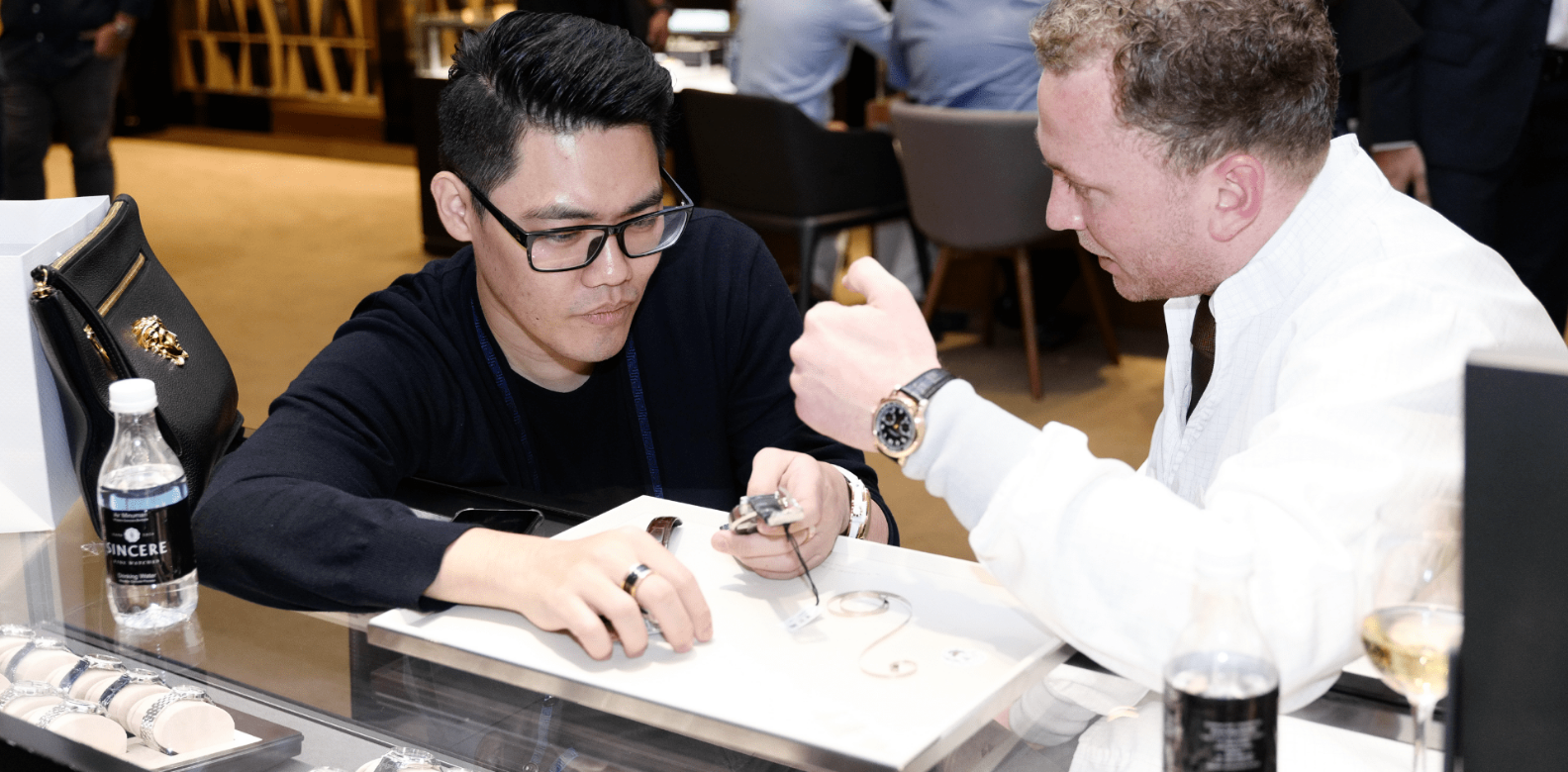 Watchmaker and head of A. Lange & Söhne's Zeitwerk department Robert Hoffmann leading a guest through the inner workings of a watch (Photo: Sincere Fine Watches)