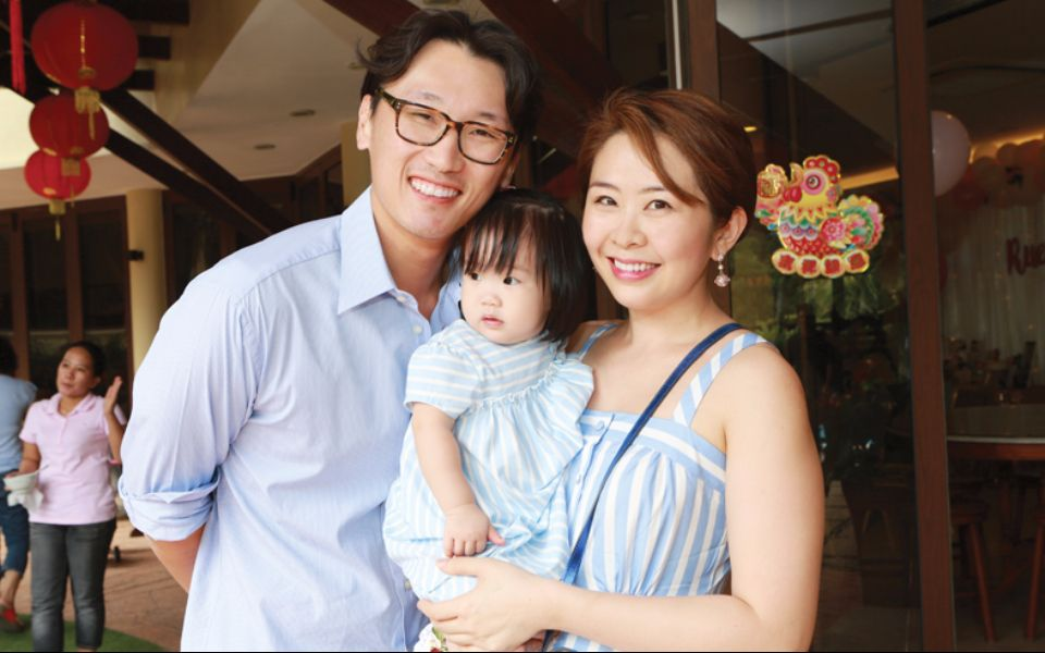 Proud parents Tan Shen Wain and Lim Ai San with birthday girl Tan Rue Mae.