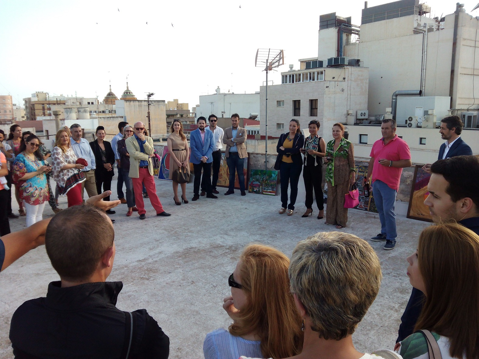 Welcome drinks and art show at rooftop home of local artist, Adela Abad