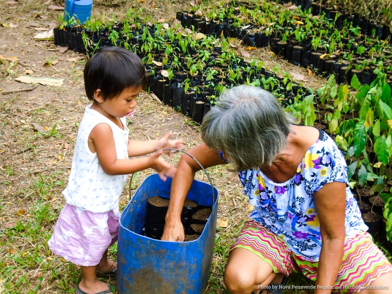 Young & old visit the nursery every Wednesday. 'We know that it is our children who will benefit from what we do here,' remarks a SCFA member. By Nova Regalario.jpg