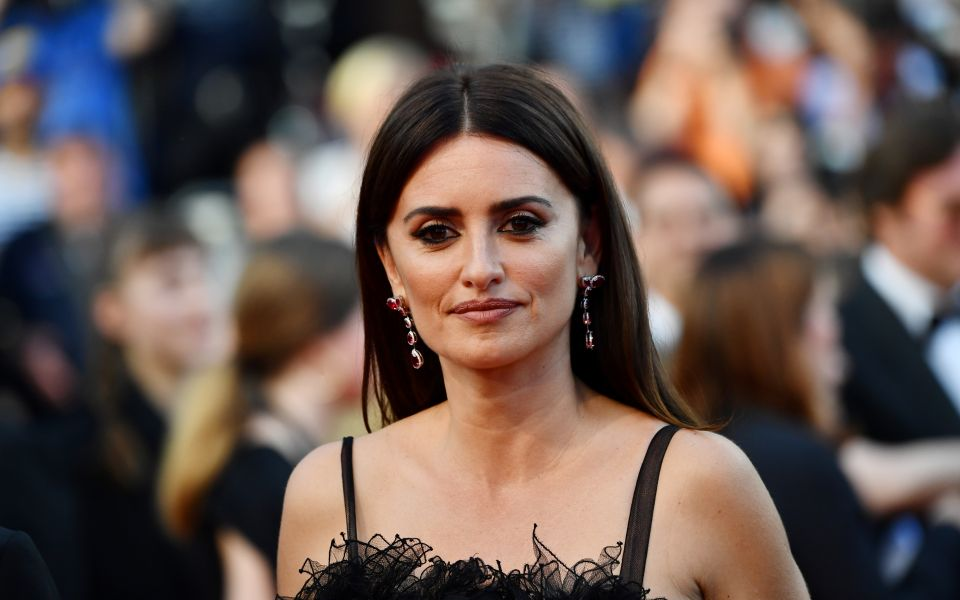 Penelope Cruz wore 18-carat white gold, diamond and ruby earrings from her new sustainable fine jewelry collection with Atelier Swarovski, which will be unveiled in July.