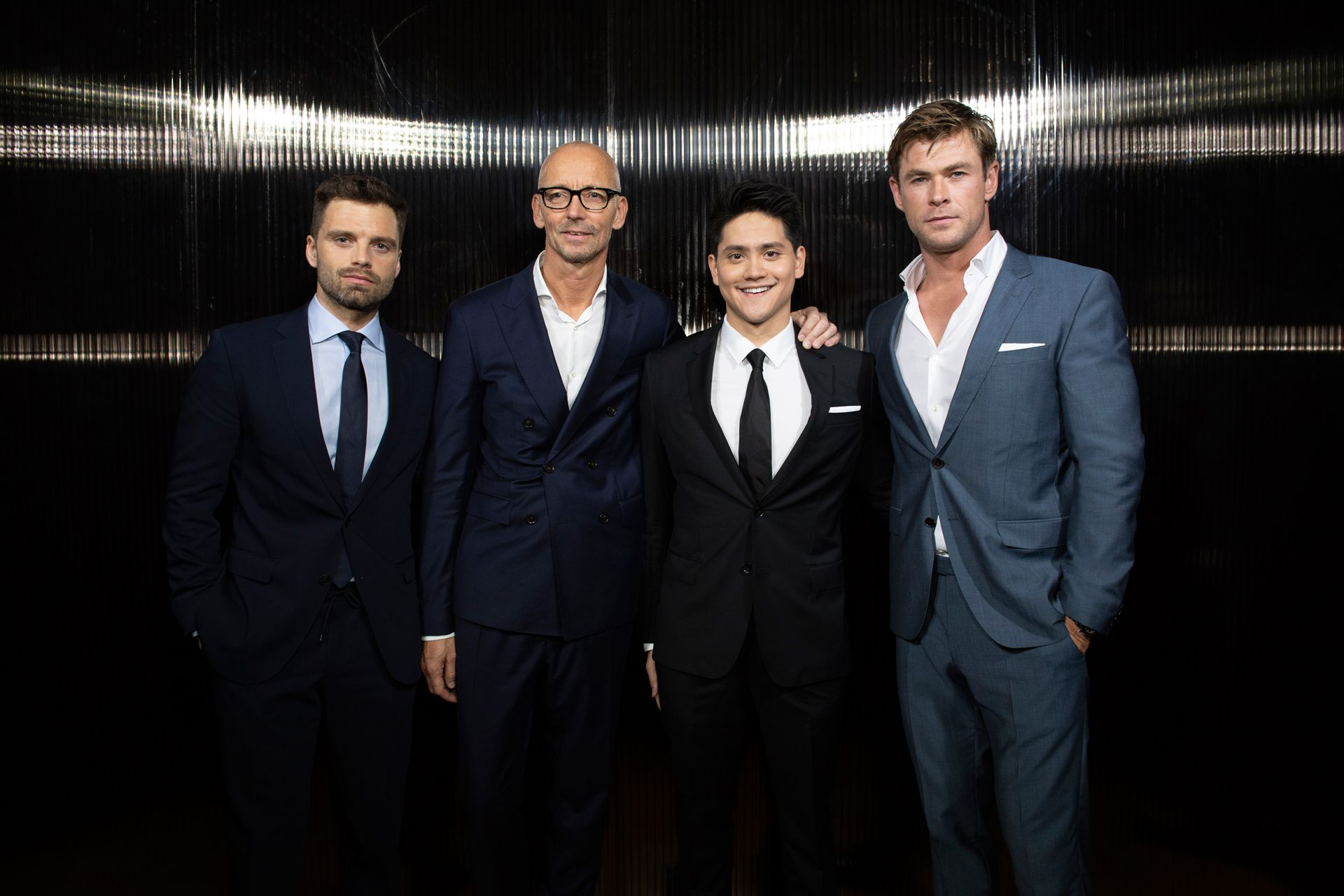 Sebastian Stan, Ingo Wilts (CBO HUGO BOSS), Joseph Schooling, and Chris Hemsworth in BOSS
