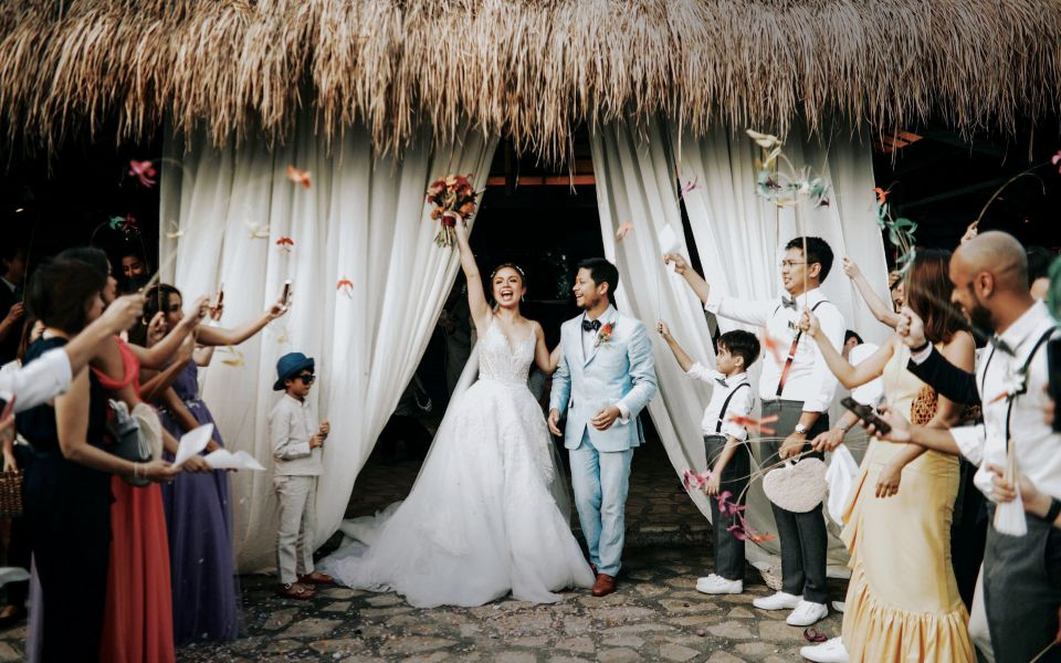 Bryan Prieto and Tinkay Soler Crespo emerge fromt the Balesin Chapel as man and wife