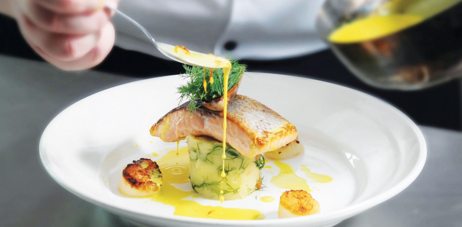 Pan-fried salmon and scallops served with crushed potato