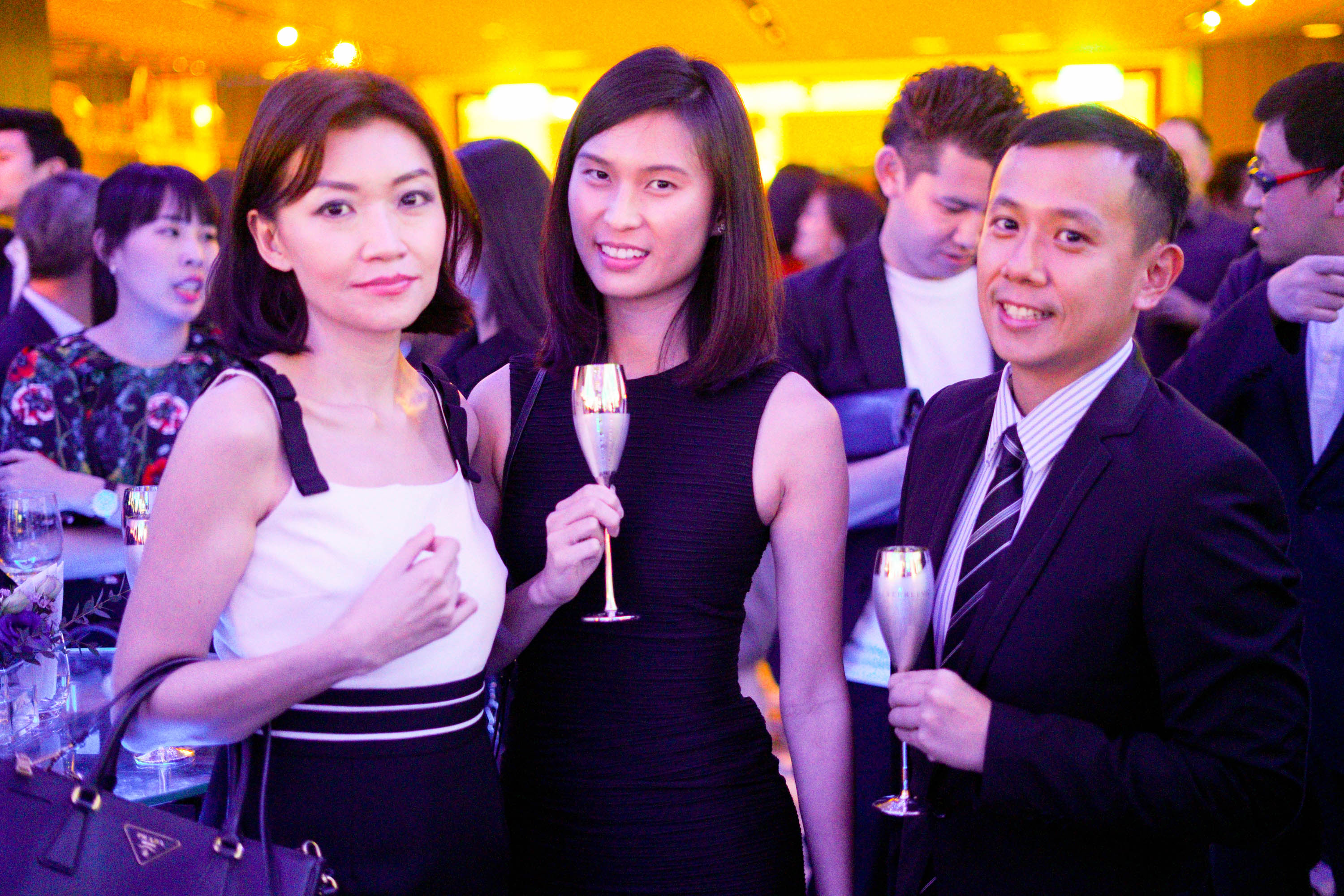 Guests enjoying the sparkling wine in one-of-a-kind silver flutes